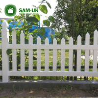 4 foot scalloped vinyl picket fence on uneven ground