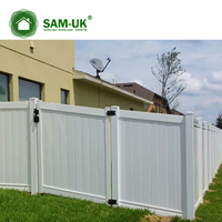 6' x 8' vinyl privacy fence double gate on a slope hill