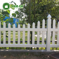 4 foot scalloped vinyl picket fence on hill